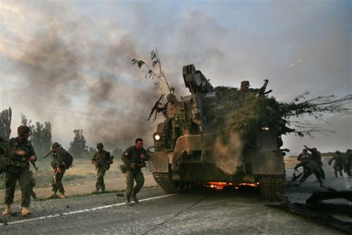 180719-georgia-russia-war-mc-1152_e6ddd220a0947b75d9788a50ec3a9a17_fit-560wGeorgian soldiers escape a burning armoured vehicle in August 2008. Russian Invasion