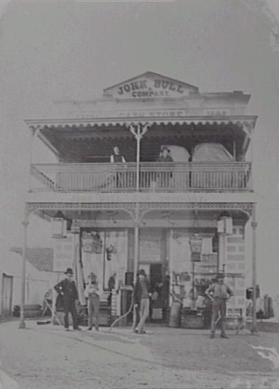 The Landowner's Secret by Sonya Heaney. John Bull's Store, Queanbeyan Australia, c. 1883. From Queanbeyan–Palerang Libraries Historical Photos.