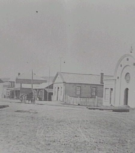 The Landowner's Secret by Sonya Heaney. Monaro Street, looking East, Queanbeyan c. 1880. From Queanbeyan–Palerang Libraries Historical Photos.